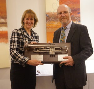Simon Davenport receives the Trumpet Blower Award from Minette Batters, Deputy President NFU